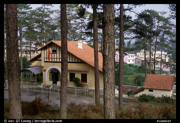 Basque style villa of colonial period in the pine-covered hills. Da Lat, Vietnam (color)