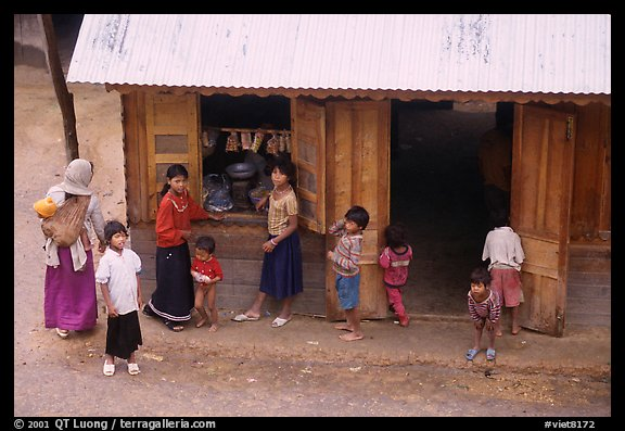 Gathering at the village store, in a minority village. Da Lat, Vietnam (color)