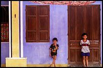 Children in front of old house, Hoi An. Hoi An, Vietnam ( color)