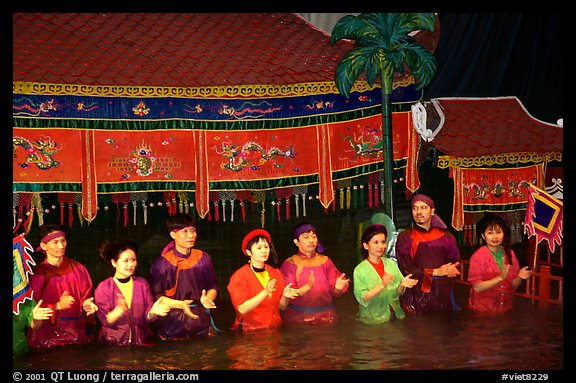 Artists salute after a water puppets performance in 1999. Hanoi, Vietnam (color)