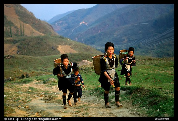 Hmong women returning to their village, which cannot be reached by the road. Sapa, Vietnam (color)