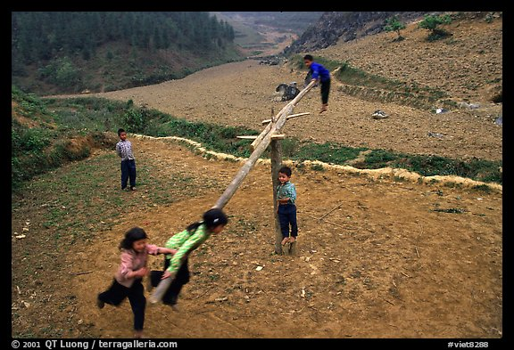 Children playing a rotating swing near Can Cau. Vietnam (color)