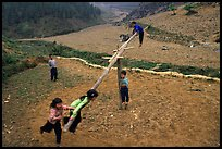 Children playing a rotating swing near Can Cau. Vietnam