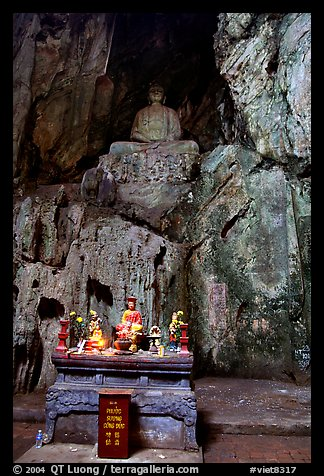 Altar and Buddha statue in a troglodyte sanctuary of the Marble Mountains. Da Nang, Vietnam (color)