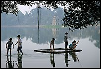 Children playing,  Hoan Kiem Lake. Hanoi, Vietnam (color)